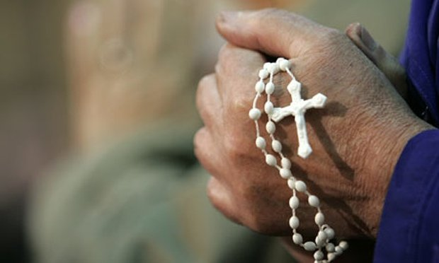 a-rosary-is-held-during-p-001.jpg.jpe