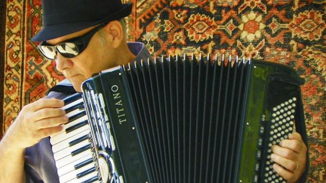 guy and accordion.jpg.jpe