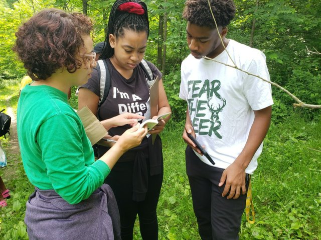 Ms. Nicole environmental educator teaching teens at Nature Center.jpg